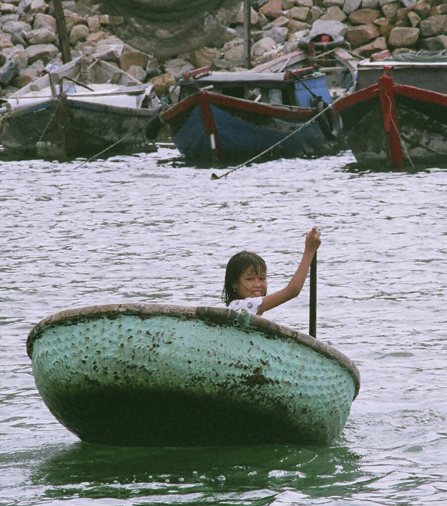 Woven Bamboo Basket Boat with Young Paddler