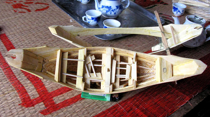 Two Model Basket Boat frames at different stages of construction.