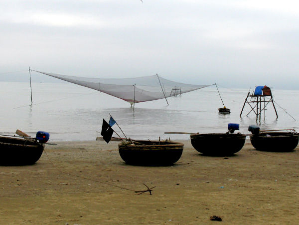 Fishnet in the raised position with several basket boats and the fishing tower, Ron, Vietnam